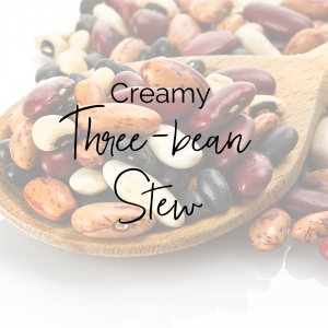 picture of different types of dry beans in a wooden spoon