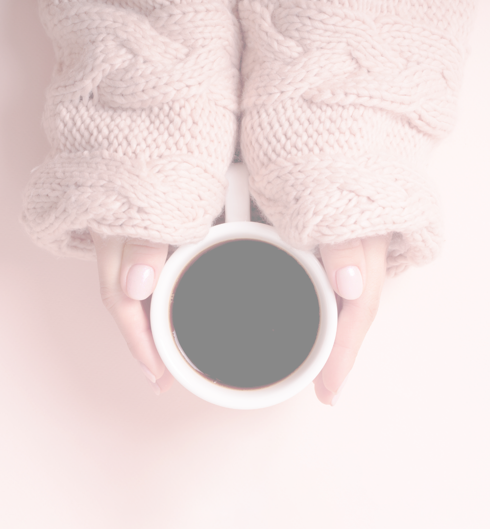 Black coffee in a white mug held in the hands of a white woman