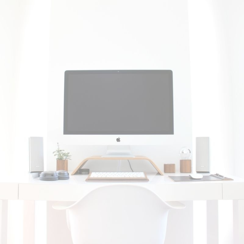 white desk with large computer monitor