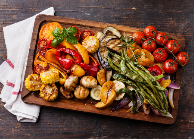 Cutting board full of a variety of grilled vegetables