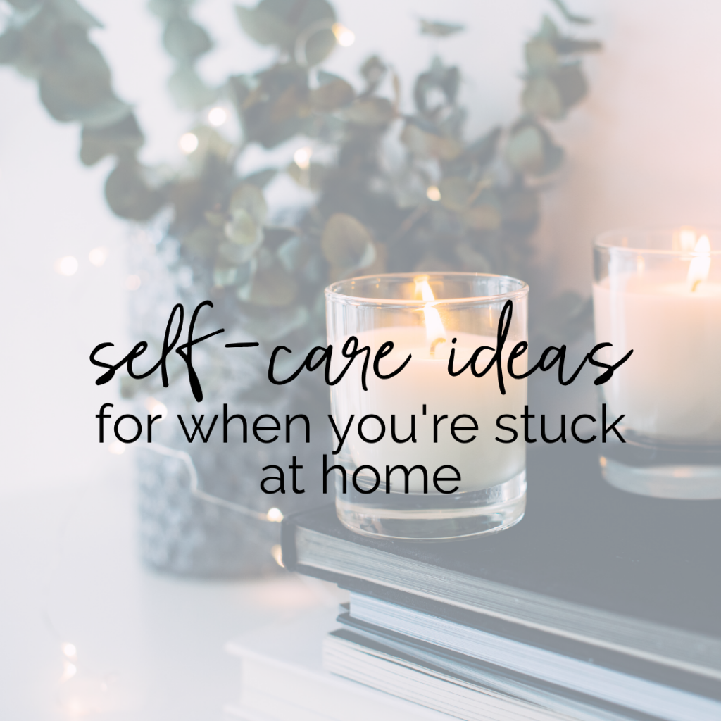 "Stock photo of a stock of books with two lit candles on top, with a vase of dried eucalyptus with string lights in the background. Text overlay says ""self-care ideas for when you're stuck at home"""