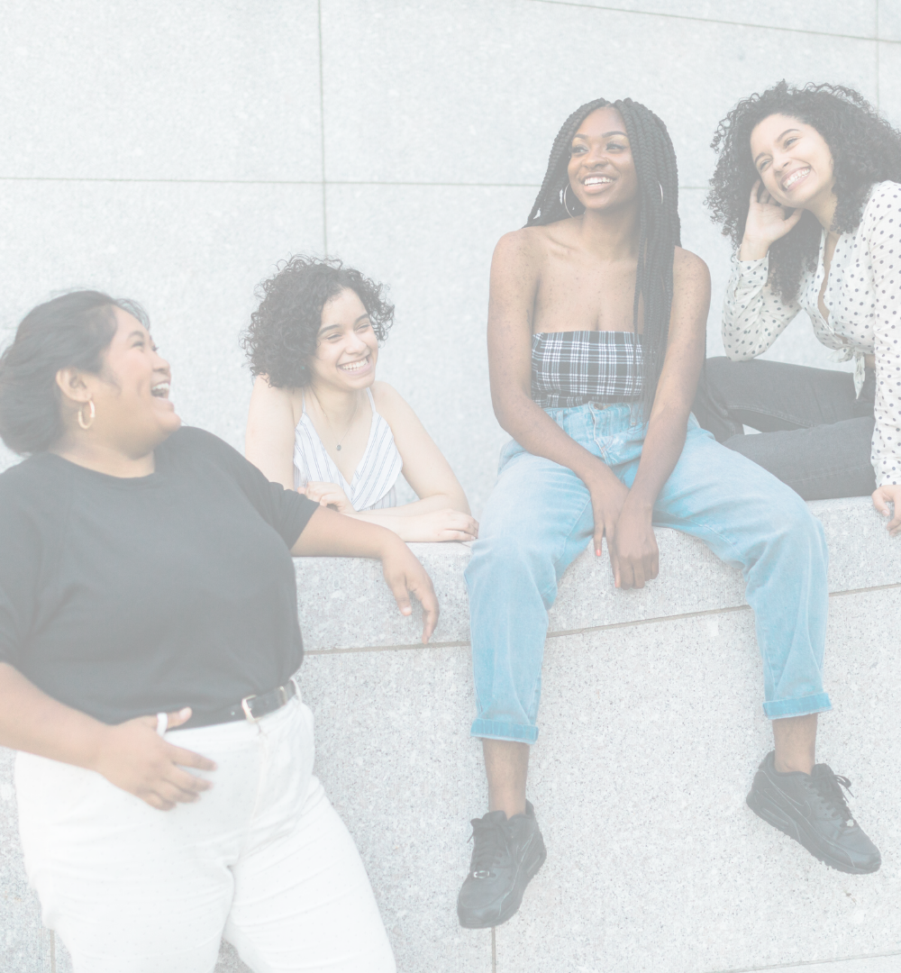 A diverse group of four young women