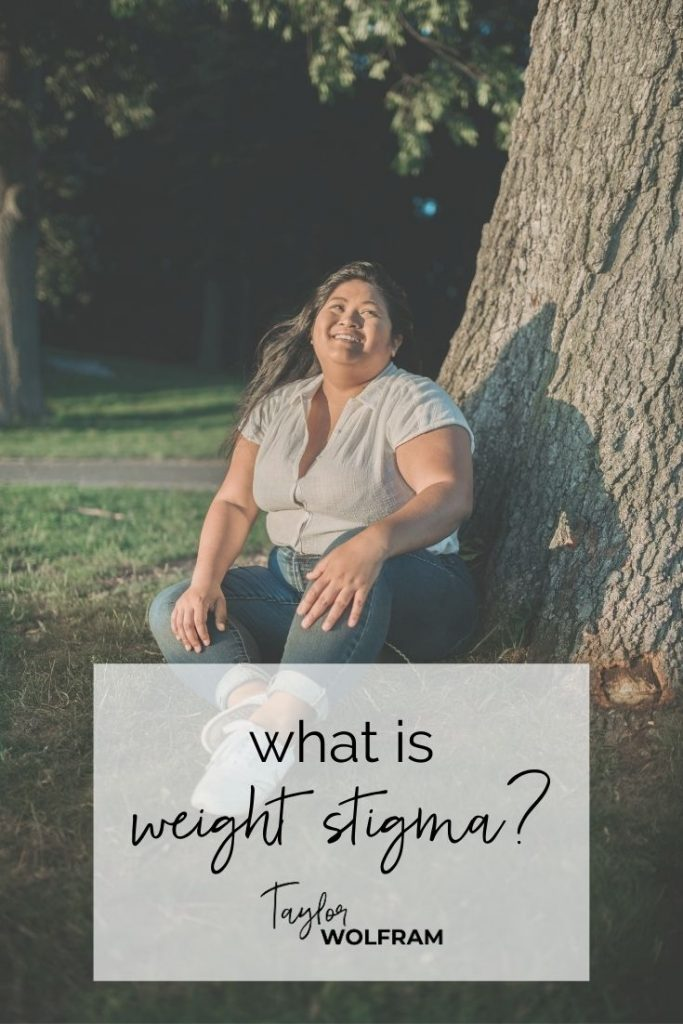 "fat woman smiling, sitting at the base of a tree. text says ""what is weight stigma?"""