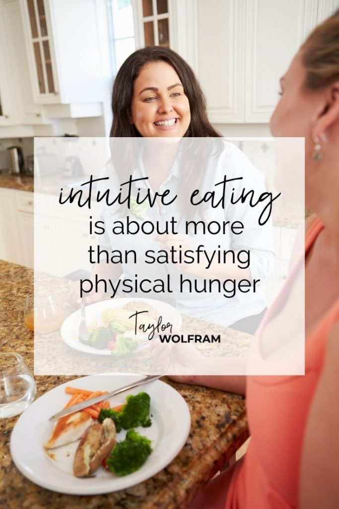 """Two happy women eating and talking in a kitchen. Text overlay says """"intuitive eating is about more than satisfying physical hunger"""""""