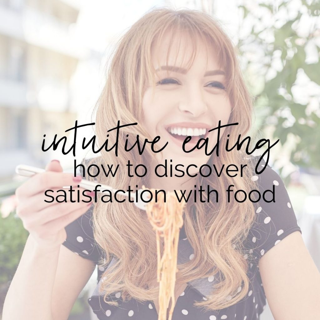 """Happy woman eating pasta with text that says """"intuitive eating how to discover satisfaction with food"""""""