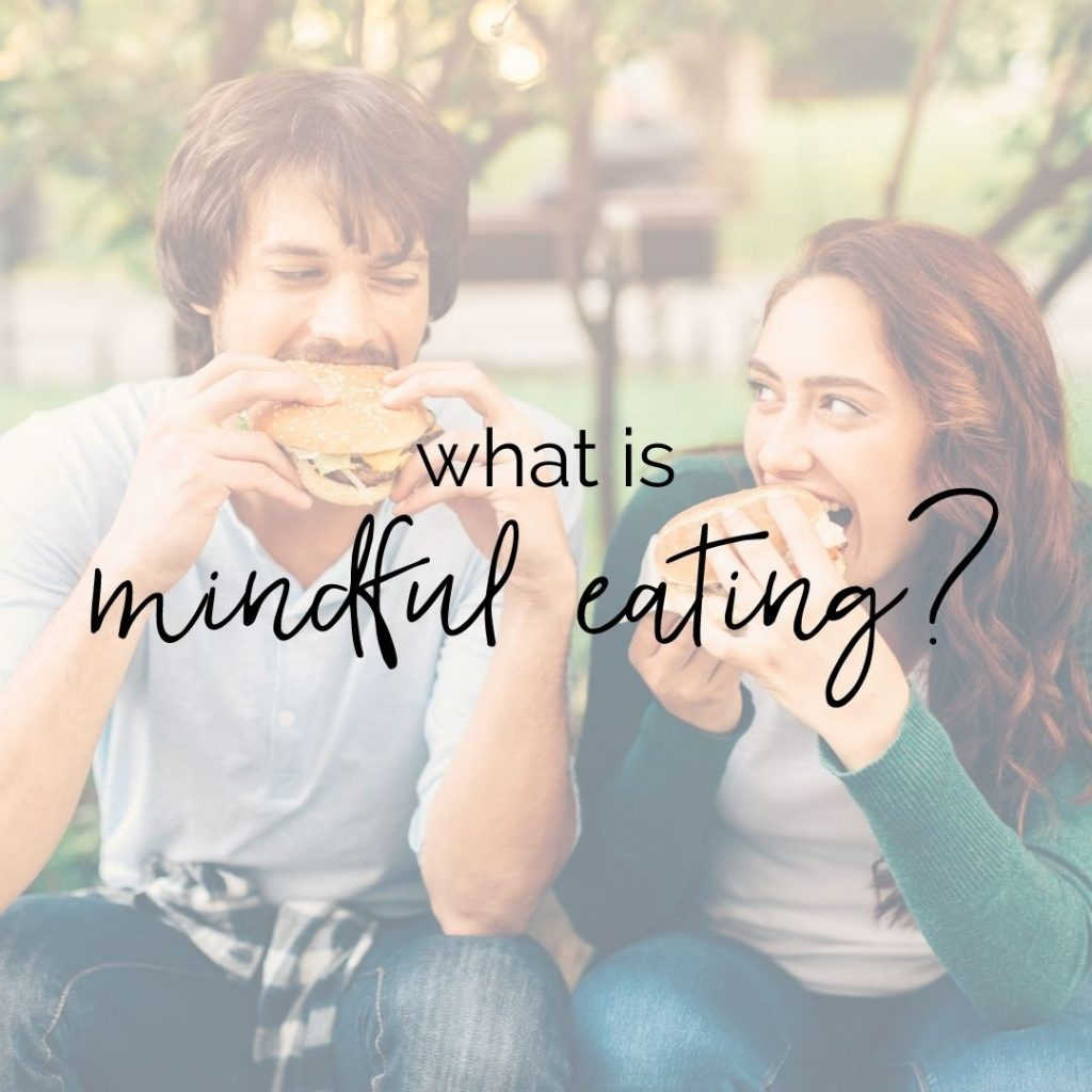 """Two people eating sandwiches, looking at each other. Text overlay says """"what is mindful eating?"""""""