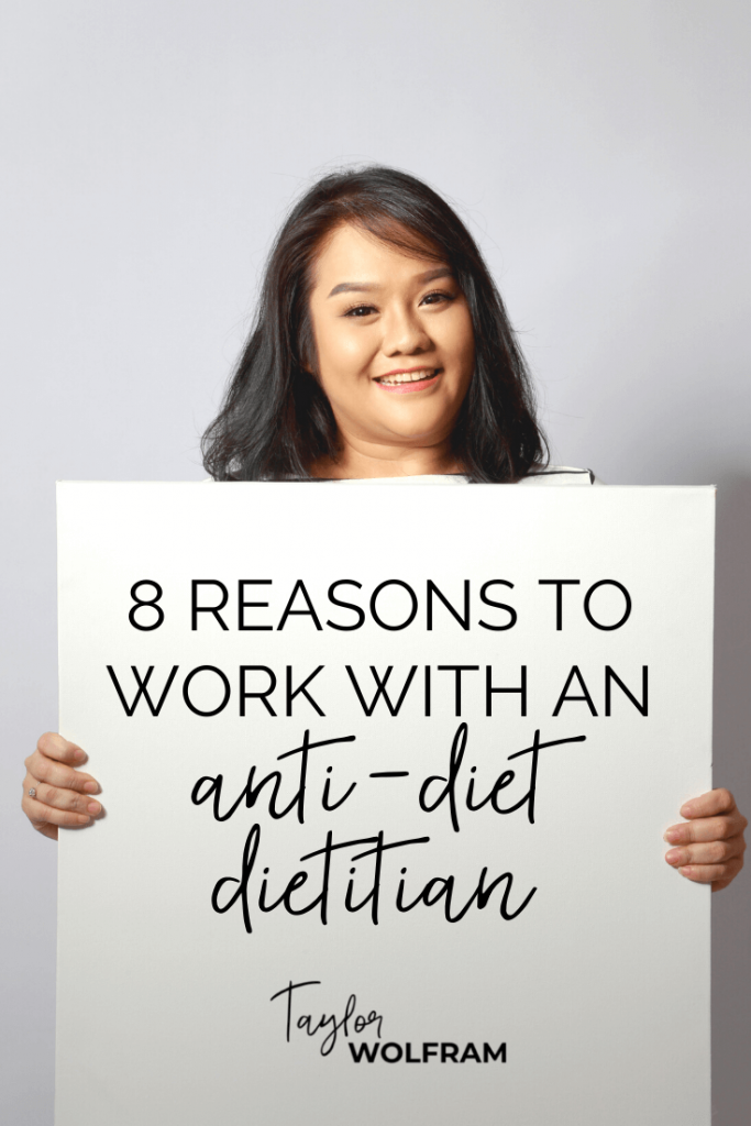 """An Asian woman holding up a blank sign with text overlay that says """"8 reasons to work with an anti-diet dietitian"""""""